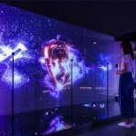 "Create your own custom art piece by interacting with ""The Art of You,"" a large-scale digital wall in the Future X Smart Store that reads your facial expressions as well as head, eye and mouth movements. (Photo: ©The Procter & Gamble Company)"