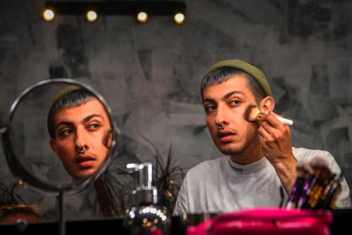 Beauty blogger Gevorg, 26, puts makes on his face as he attends an...